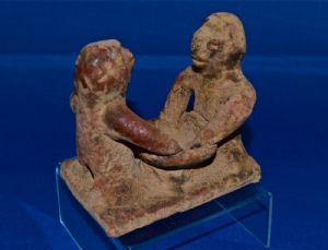 An extremely rare Pre-classic period Mayan pottery figurative oil lamp. SOLD